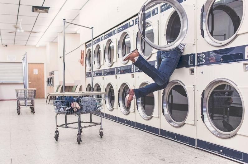 Woman stuck in landromat washing machine